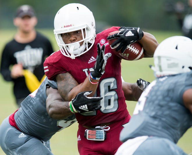 Troy University runningback B.J. Smith carries the ball during the scrimmage in Troy, Ala. on Saturday August 11, 2018.