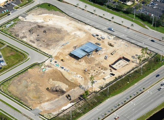 This July aerial photo shows the RaceTrac store and gas station under construction on the southwest corner of Collier Boulevard, bottom right, and Rattlesnake Hammock Road in East Naples.
