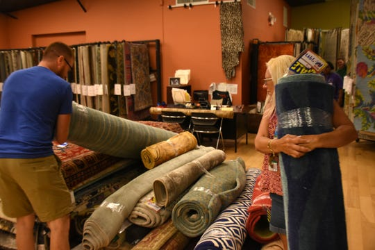 Brandon Heimberger and his mother Pam Heimberger, both teachers, select their carpets. Hadinger Flooring in Naples hosted their ninth annual Teacher Rug Giveaway event Saturday, Aug. 11, 2018. Hadinger Flooring donated free area rugs to educators who showed up at the store on Airport-Pulling Road.