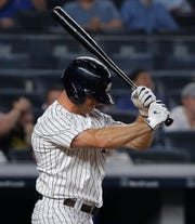 New York Yankees' Brett Gardner reacts after striking out swinging during the eighth inning of the team's baseball game against the Texas Rangers, Friday, Aug. 10, 2018, in New York.
