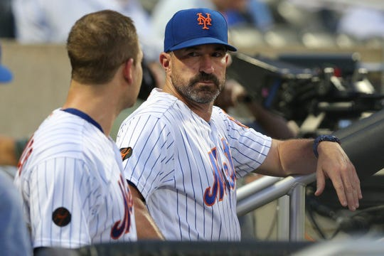 Jul 24, 2018; New York City, NY, USA; New York Mets manager Mickey Callaway talks to New York Mets catcher Devin Mesoraco (29) in the dugout during the third inning against the San Diego Padres at Citi Field.
