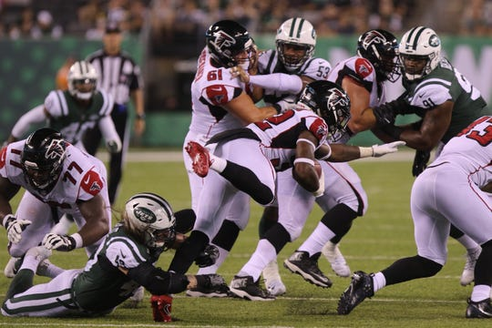 Dylan Donahue of the Jets takes down Tyson Graham of the Falcons in the fourth quarter on Friday, Aug. 10, 2018 at MetLife Stadium, East Rutherford, in a preseason game. The Jets won, 17-0.