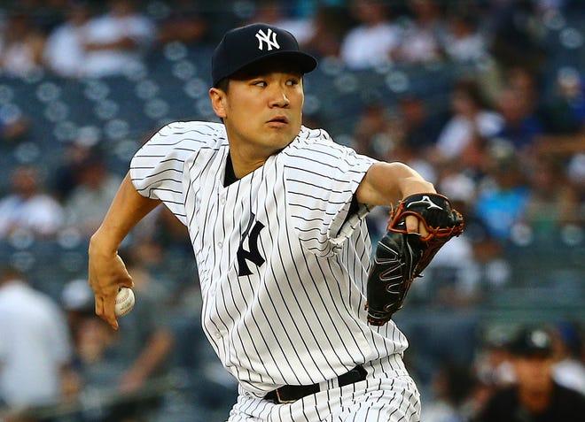 Aug 10, 2018; Bronx, NY, USA; New York Yankees starting pitcher Masahiro Tanaka (19) pitches against the Texas Rangers during the first inning at Yankee Stadium.