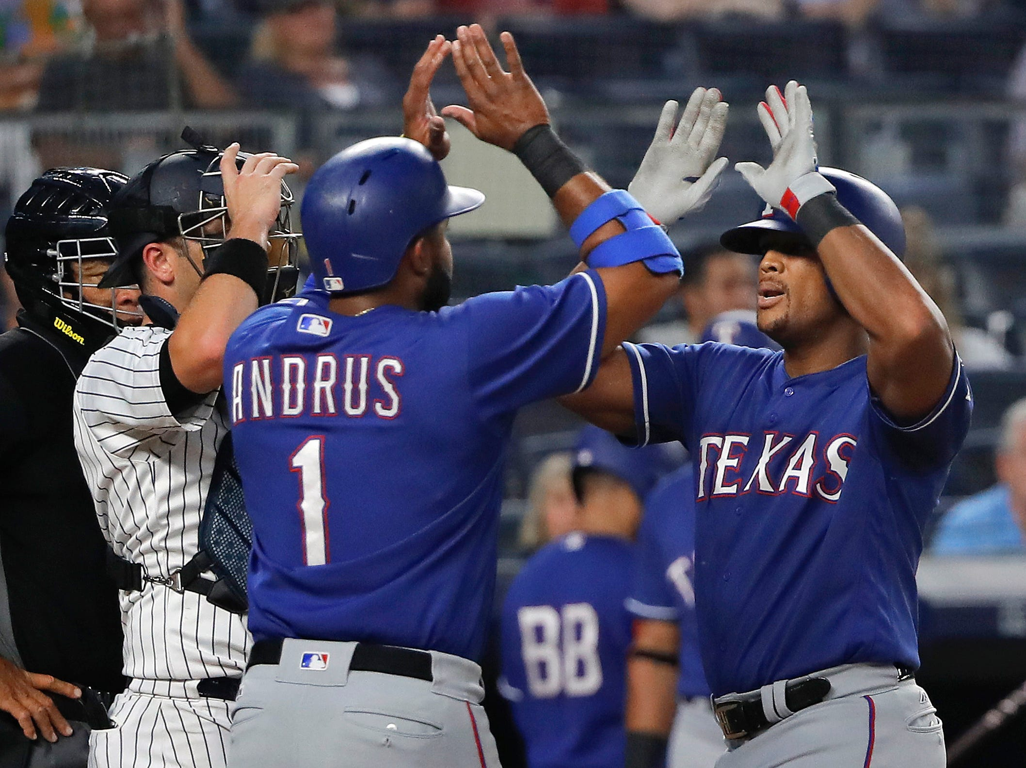 Texas Rangers' Adrian Beltre, right, is congratulated by Elvis Andrus (1) after hitting a two-run home run against the New York Yankees during the fourth inning of a baseball game Friday, Aug. 10, 2018, in New York.