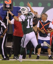 Sam Darnold celebrates throwing his first touchdown pass as a NY Jet during a preseason game against the Atlanta Falcons at MetLife Stadium, East Rutherford, on Friday, Aug. 10, 2018