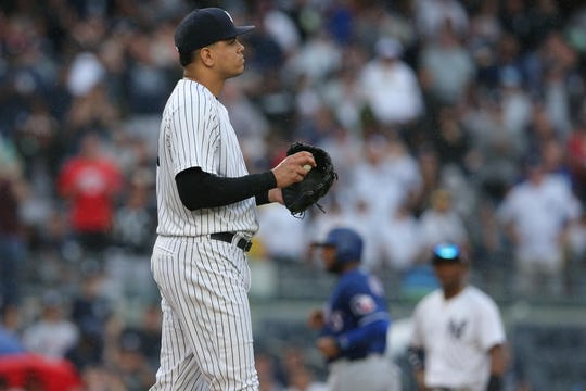 Aug 11, 2018; Bronx, NY, USA; New York Yankees relief pitcher Dellin Betances (68) reacts after a balk allowed a run to score during the seventh inning against the Texas Rangers at Yankee Stadium.