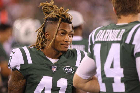 Buster Skrine, left, talking to Sam Darnold before Darnold enter the preseason game for the Jets against the Atlanta Falcons on Friday, Aug. 10, 2018 at MetLife Stadium in East Rutherford.
