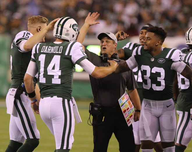 The Jets sideline greets rookie QB Sam Darnold after he threw his first touchdown pass as the Jets went on to beat the Atlanta Falcons, 17-0, in a preseason game at MetLife Stadium, East Rutherford, on Friday, Aug. 10, 2018