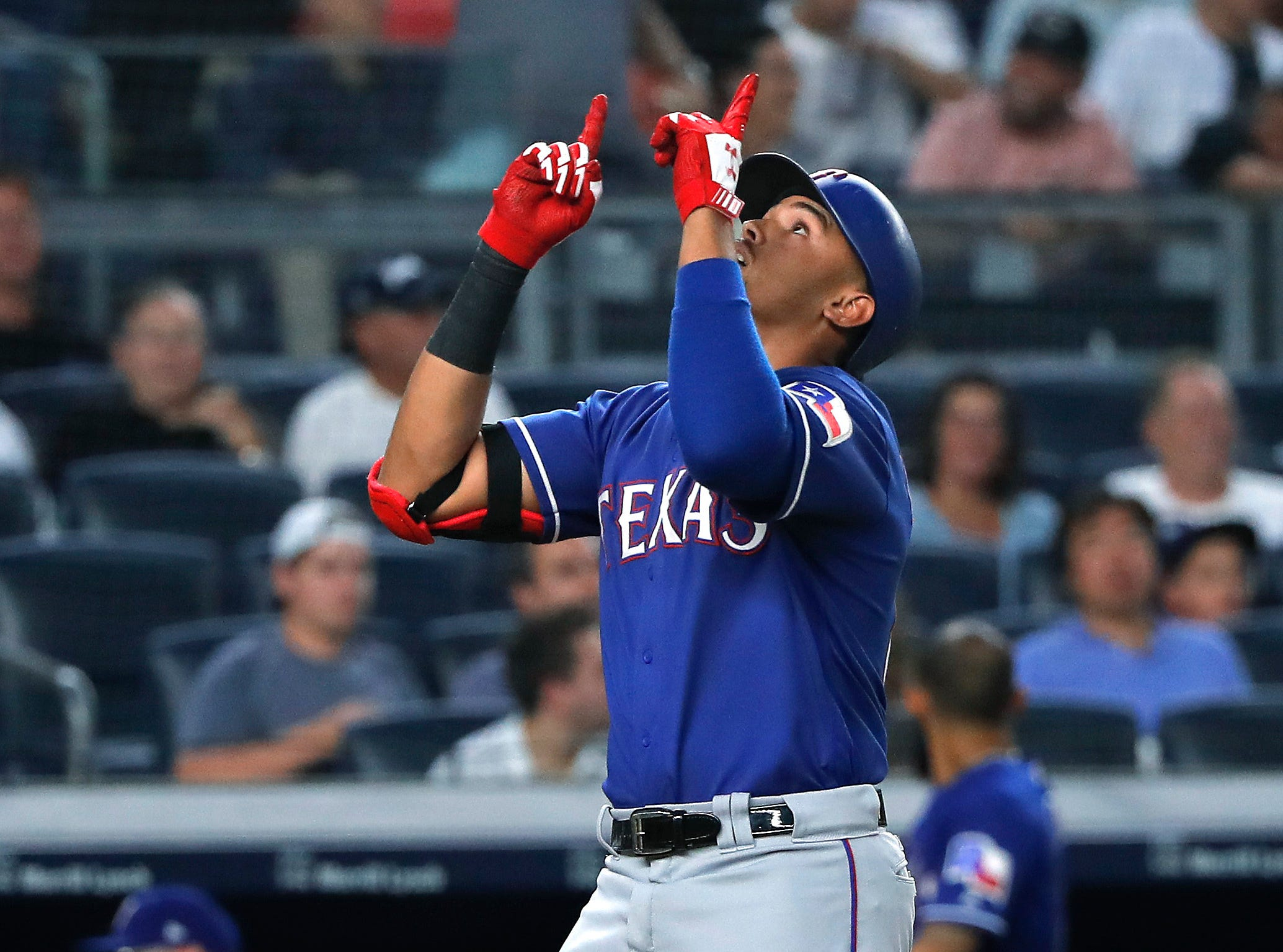 Texas Rangers' Ronald Guzman reacts as he crosses the plate after hitting a solo home run against the New York Yankees during the fourth inning of a baseball game Friday, Aug. 10, 2018, in New York.