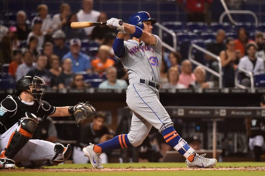 Aug 10, 2018; Miami, FL, USA; New York Mets left fielder Michael Conforto (30) singles in a run in the third inning against the Miami Marlins at Marlins Park.
