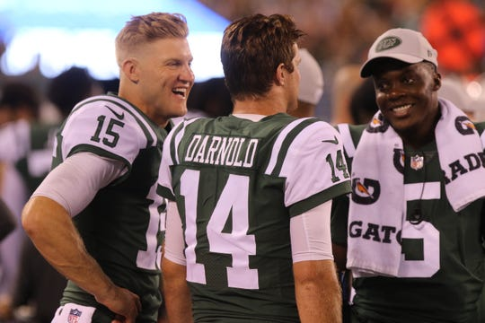 Jet quarterbacks Josh McCown, left, Sam Darnold and Teddy Bridgewater on the sidelines after Darnold threw his first touchdown pass in a preseason game against the Atlanta Falcons at MetLife Stadium in East Rutherford on Friday, Aug. 10, 2018.
