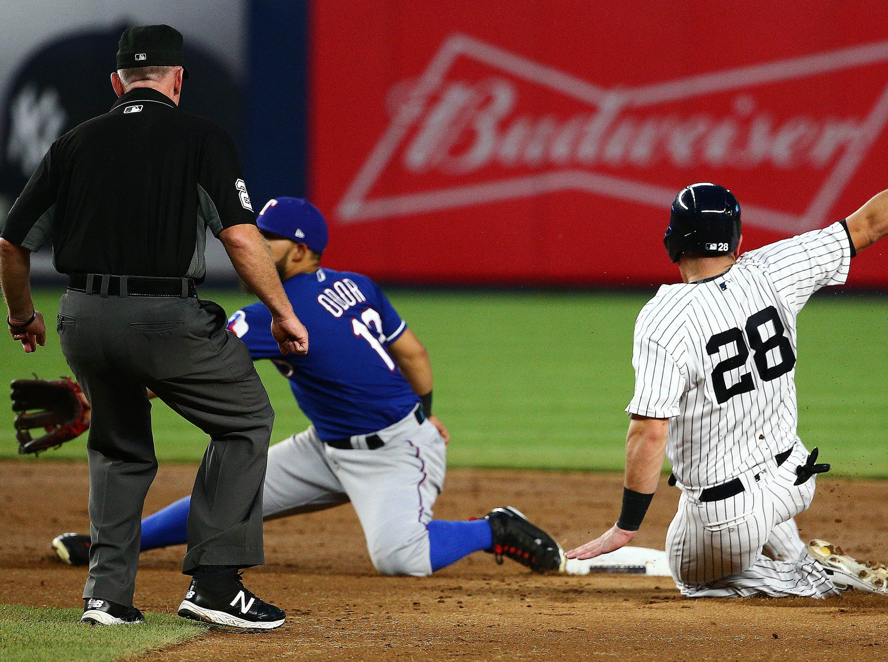 Yankees catcher Austin Romine (28) steals second base against the Texas Rangers during the third inning at Yankee Stadium.