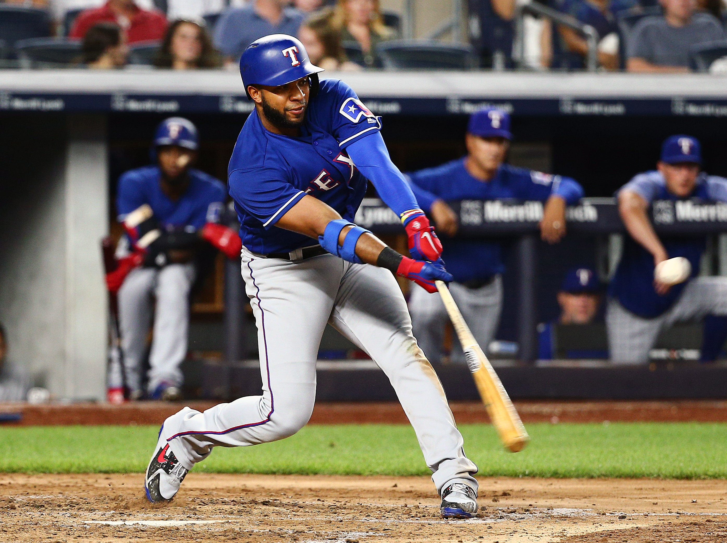 Rangers shortstop Elvis Andrus (1) hits a two RBI double against the New York Yankees during the fifth inning at Yankee Stadium.