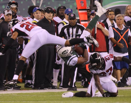 Charles Johnson of the Jets is upended by Damontae Kazee of the Falcons during their preseason game at MetLife Stadium in East Rutherford on Friday, Aug. 10, 2018.