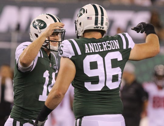 Sam Darnold and Henry Anderson celebrates Darnold's first touchdown pass as a NY Jet during the preseason game against the Atlanta Falcons on Friday, Aug. 10, 2018 at MetLife Stadium.