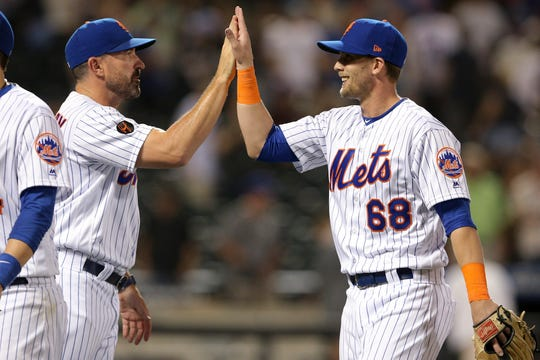 Jul 24, 2018; New York City, NY, USA; New York Mets manager Mickey Callaway celebrates with third baseman Jeff McNeil (68) after defeating the San Diego Padres at Citi Field.