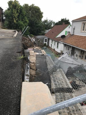A retaining wall collapsed in Fairview on Saturday, Aug. 11, 2018.