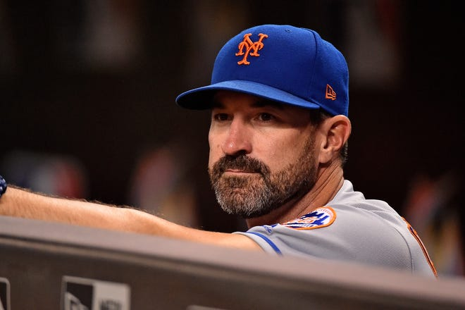 Aug 10, 2018; Miami, FL, USA; New York Mets manager Mickey Callaway (36) looks on from the dugout prior to the game against the Miami Marlins at Marlins Park.