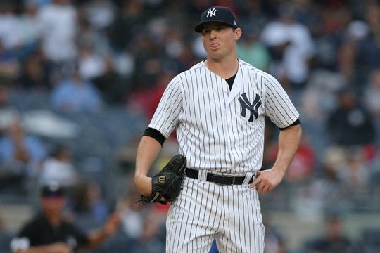 Aug 11, 2018; Bronx, NY, USA; New York Yankees relief pitcher Zach Britton (53) reacts after walking in a run during the seventh inning against the Texas Rangers at Yankee Stadium.