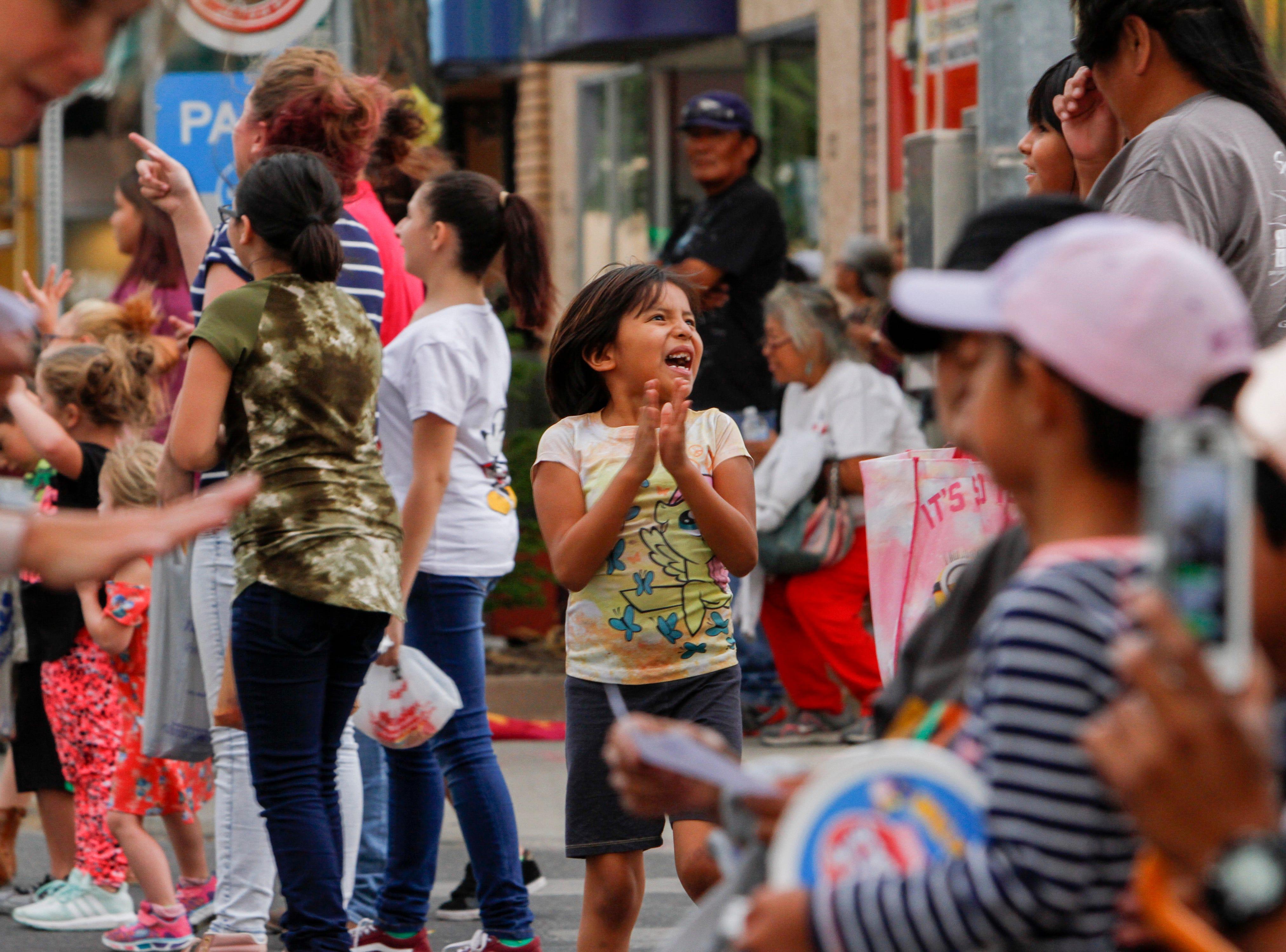 Community members enjoy the San Juan County Fair Parade, Friday, Aug. 10, 2018  on Main Street in Farmington.