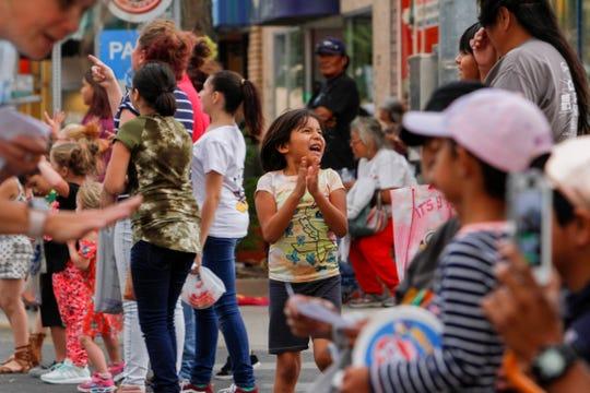Community members enjoy the San Juan County Fair Parade Friday on Main Street in Farmington.