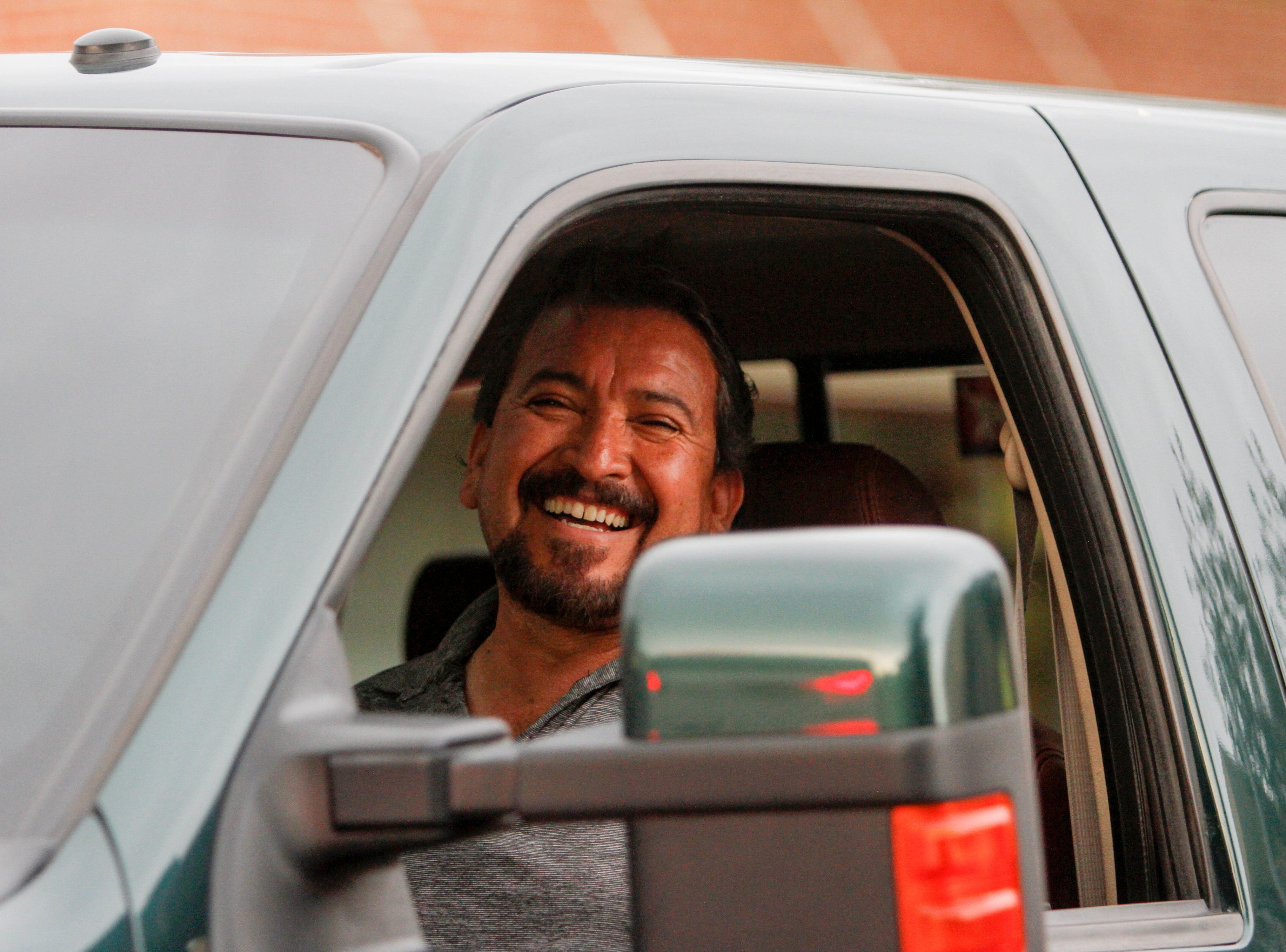 San Juan County Republican Party member Hector Rangel drives along the parade route, Friday, Aug. 10, 2018 during the San Juan County Fair Parade on Main Street in Farmington.