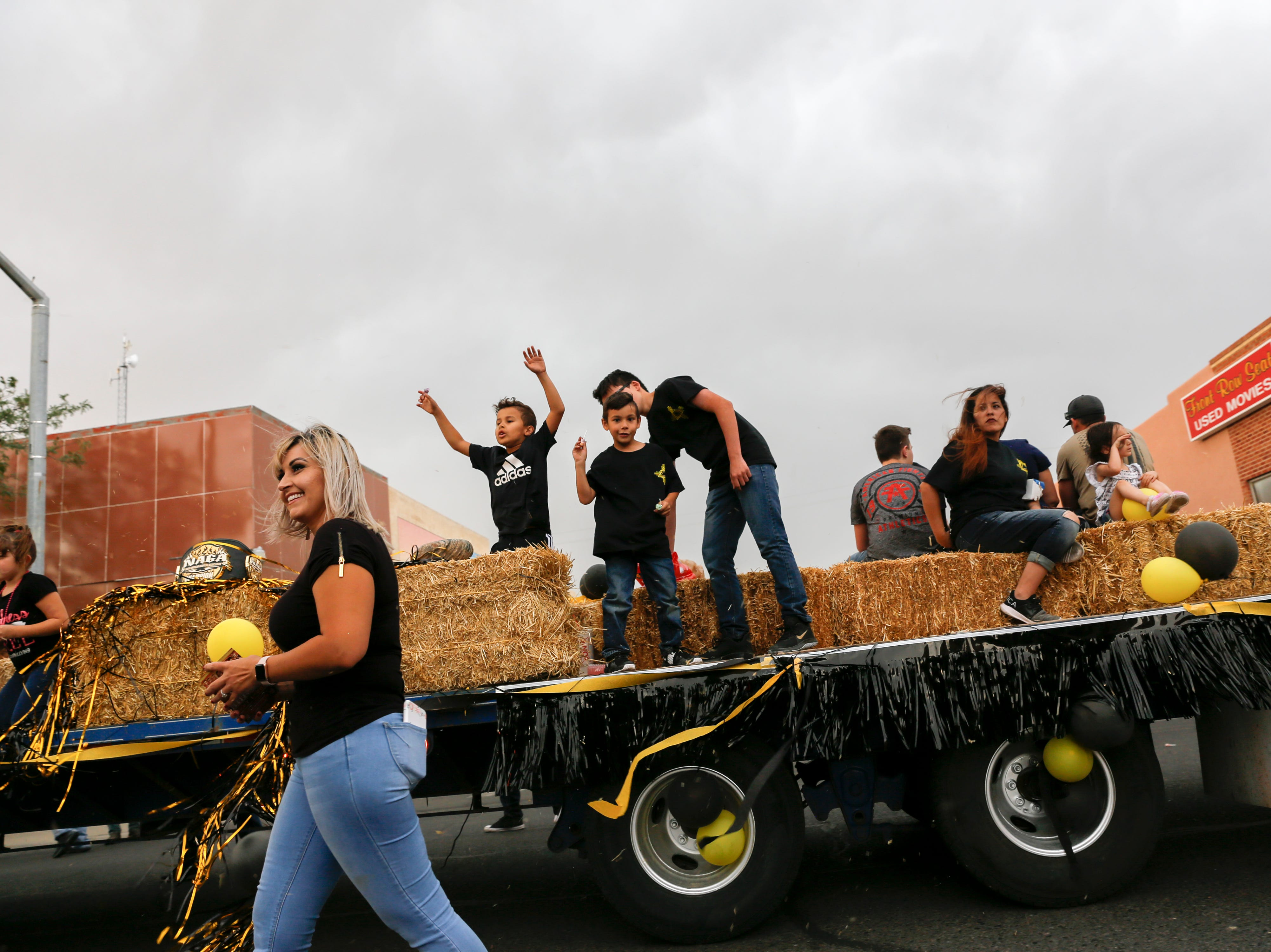 Members of the Zia Fight Club participate in the San Juan County Fair Parade, Friday, Aug. 10, 2018 on Main Street in Farmington.
