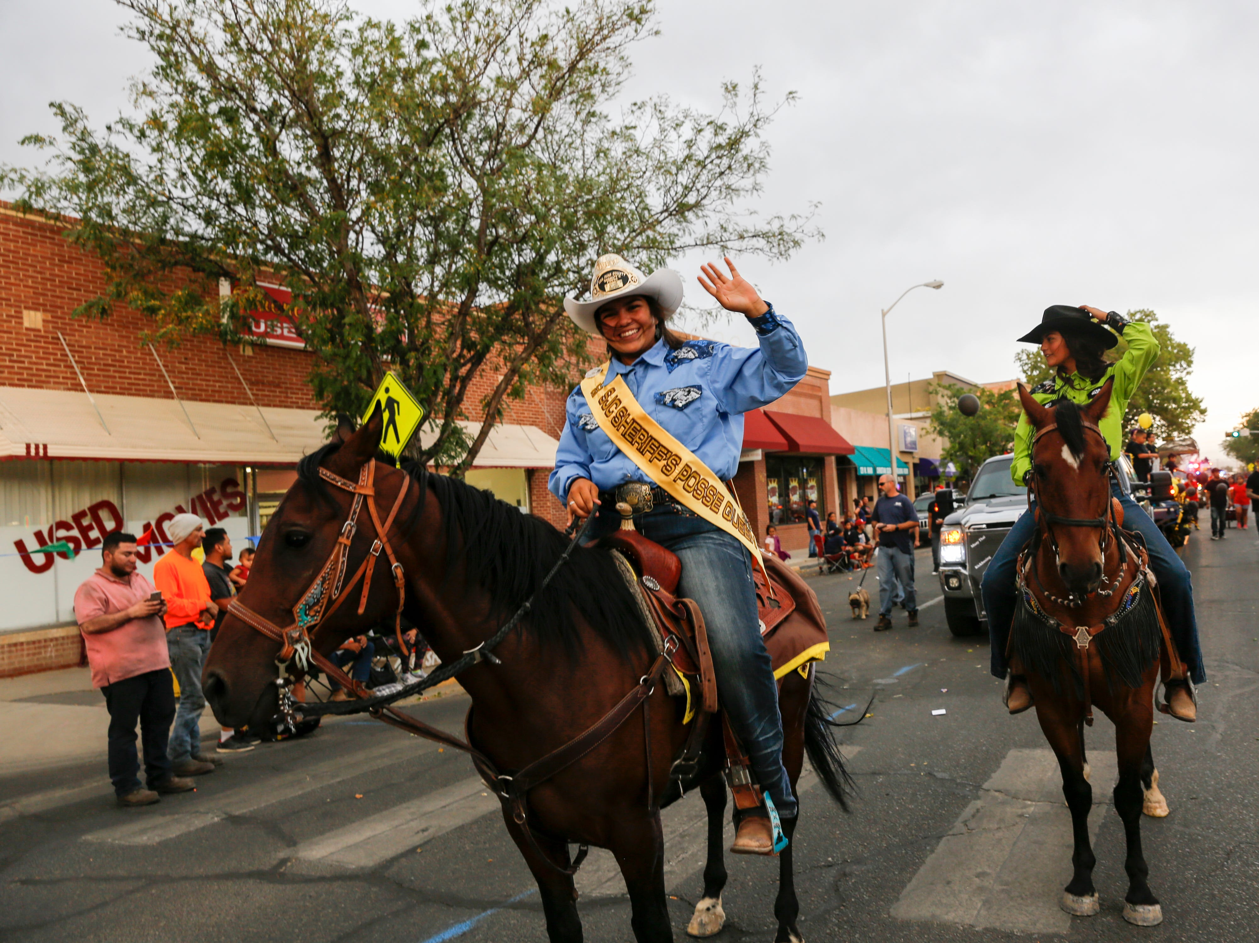 San Juan County Sheriff's Posse Queen Nevaeh Chapman, left, and her sister Sariah Chapman participate, Friday, Aug. 10, 2018 in the San Juan County Fair Parade on Main Street in Farmington.