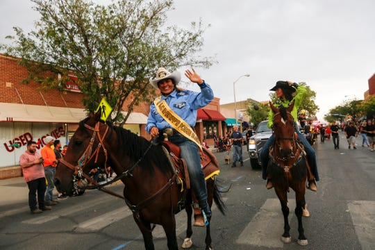 San Juan County Sheriff's Posse Queen Nevaeh Chapman, left, and her sister Sariah Chapman take part in the San Juan County Fair Parade Friday on Main Street in Farmington.
