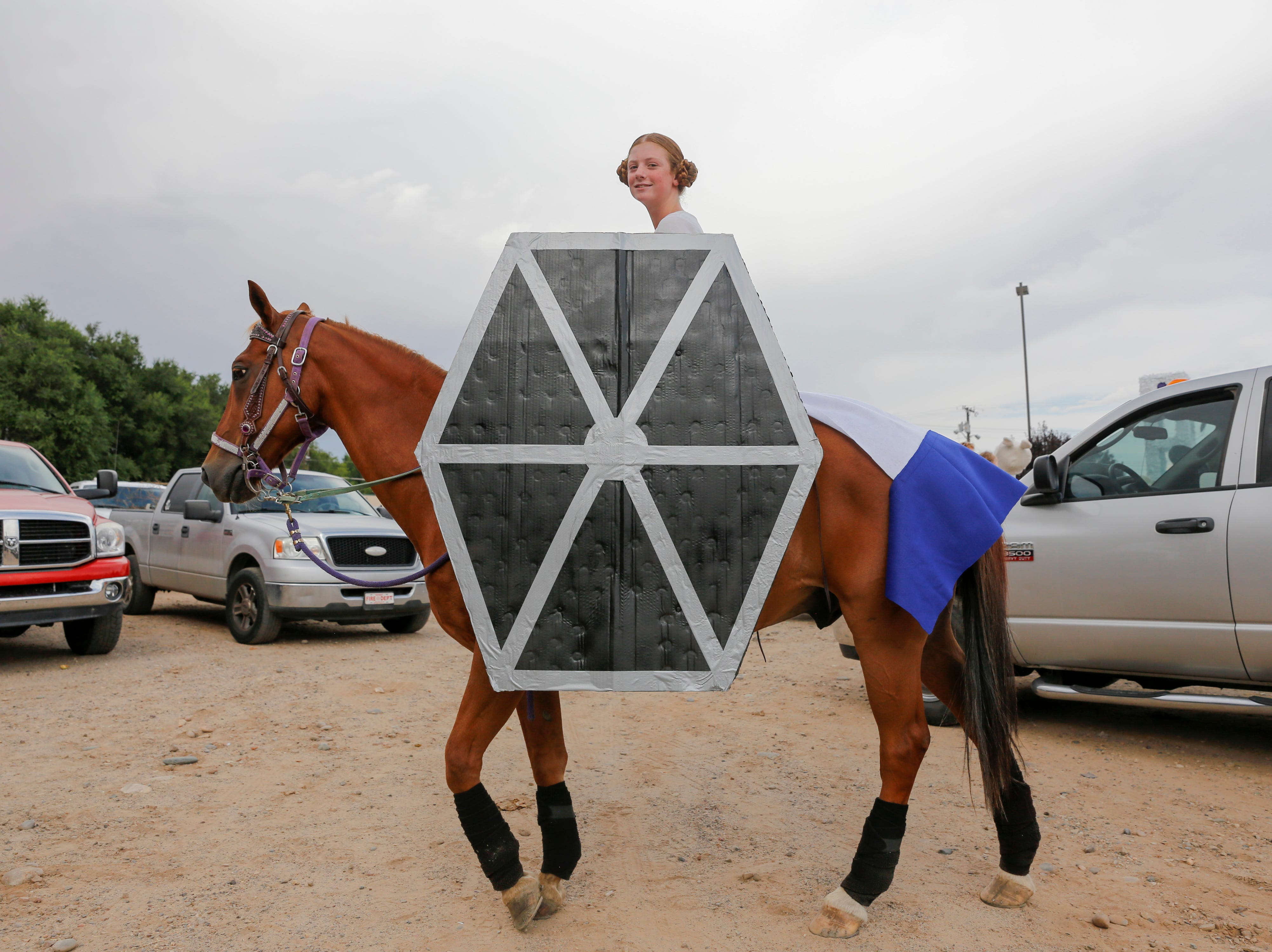 Kimber Harvey and her horse Dazzle prepare for the start of the San Juan County Fair Parade, Friday, Aug. 10, 2018 on Main Street in Farmington.