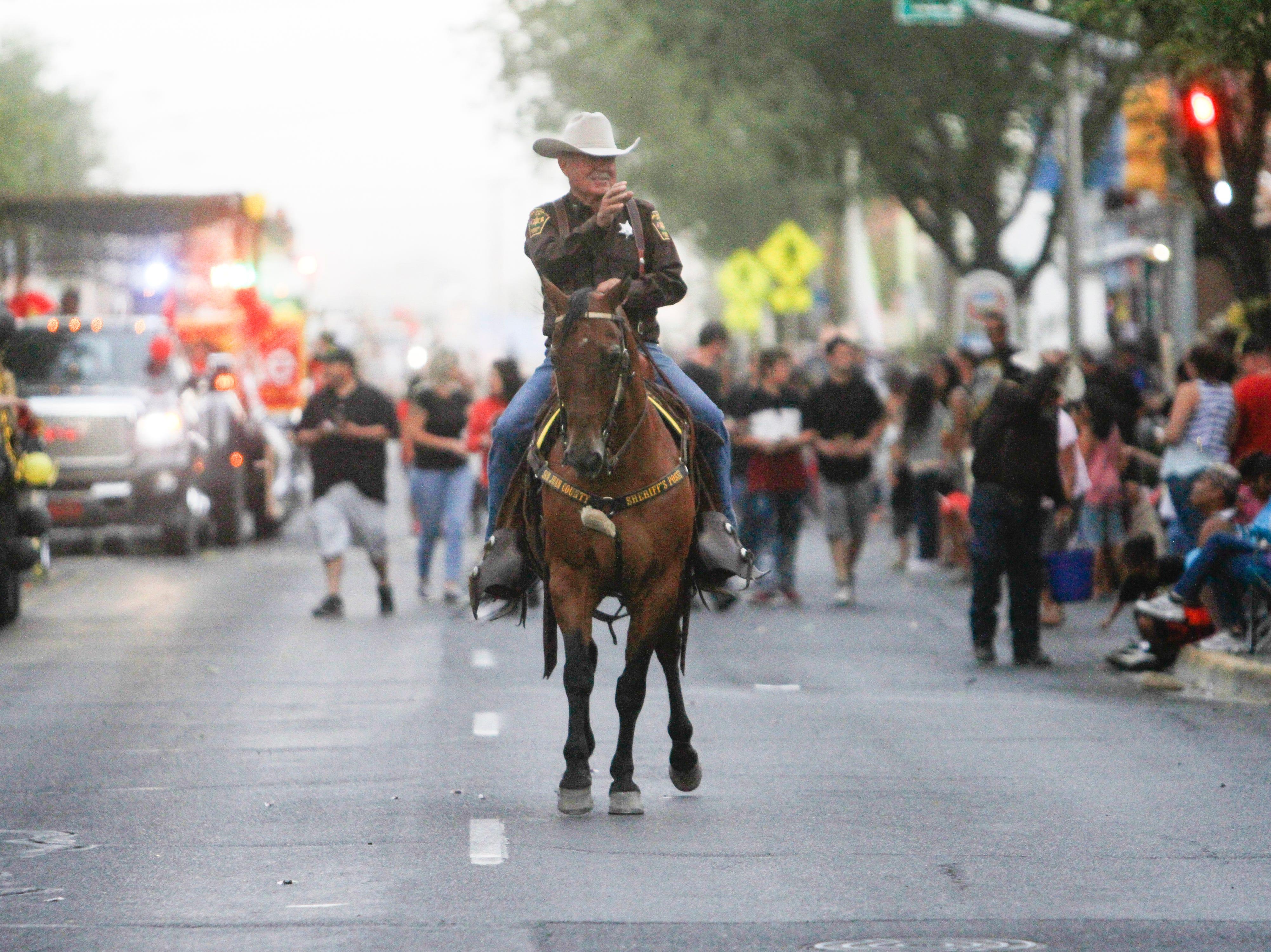 San Juan County Sheriff's Posse Capt. Dave Williams participates, Friday, Aug. 10, 2018 in the San Juan County Fair Parade on Main Street in Farmington.
