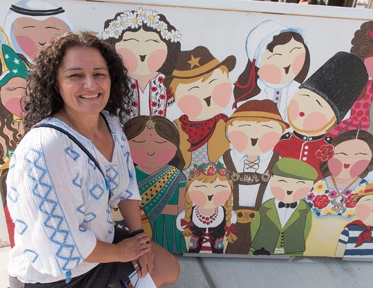 Troy artist Simona Lucut won the street art competition. Local artists painted the plywood barriers during construction.