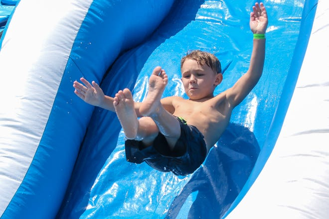 Hundreds of kids enjoy a previous Waterfest in downtown Milton. This year's fun begins on Saturday.