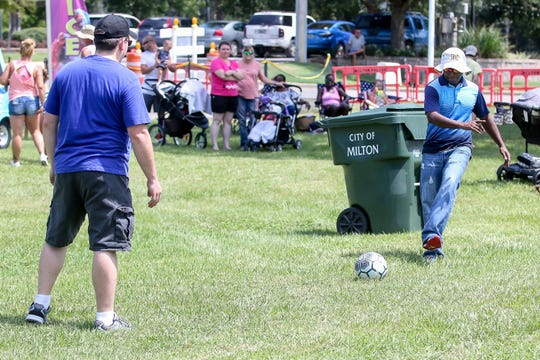 Joe Taylor, left, and Martin Mina play soccer during Waterfest, a back-to-school event sponsored by the city of Milton, in downtown Milton on Saturday, Aug. 11, 2018. The free event, featuring numerous water slides and bounce houses, was open to children 12 and younger.