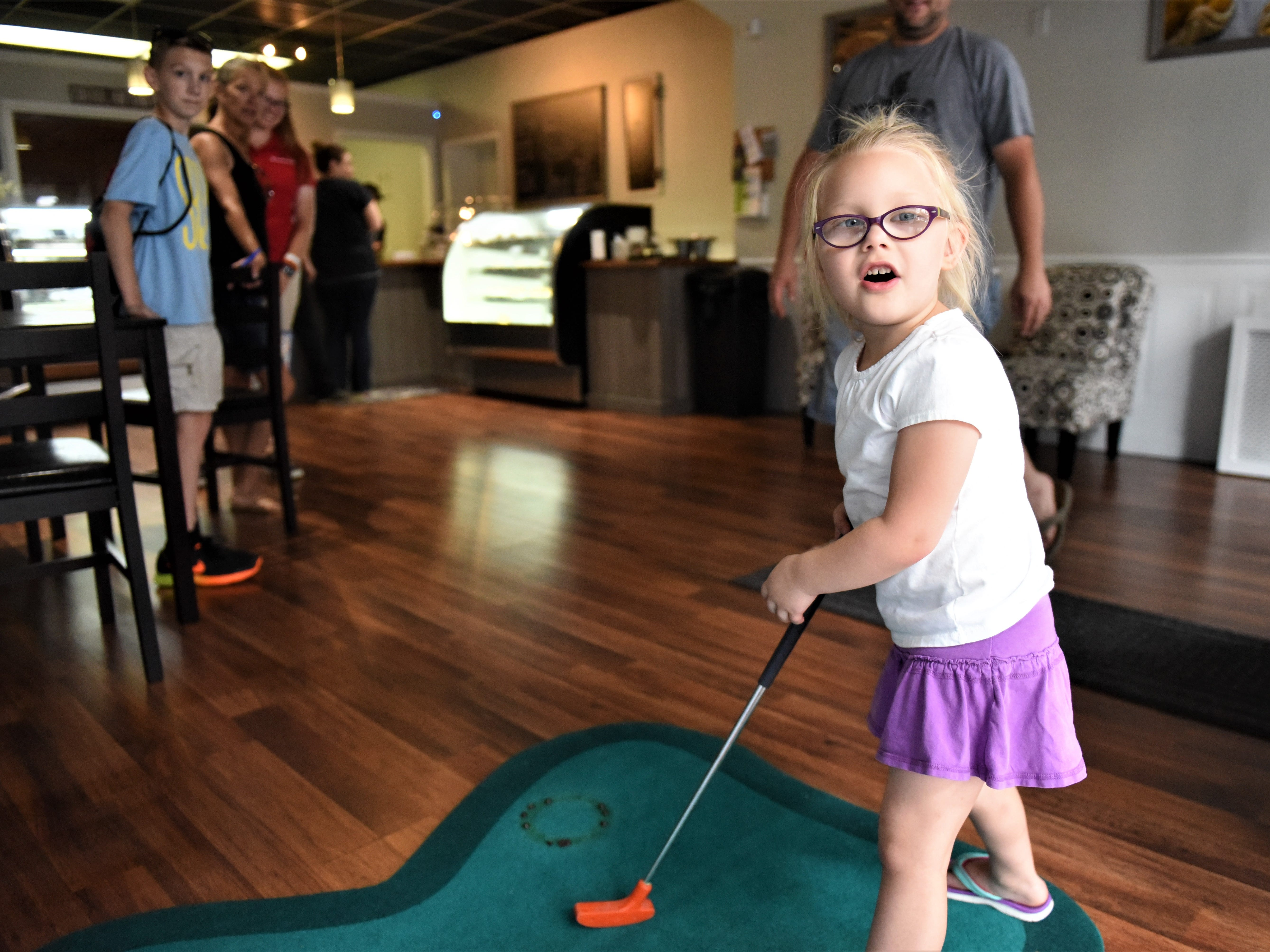Alayna Groft, 4, of Hanover, playing mini golf on Aug. 11 at Crumb and Get It.