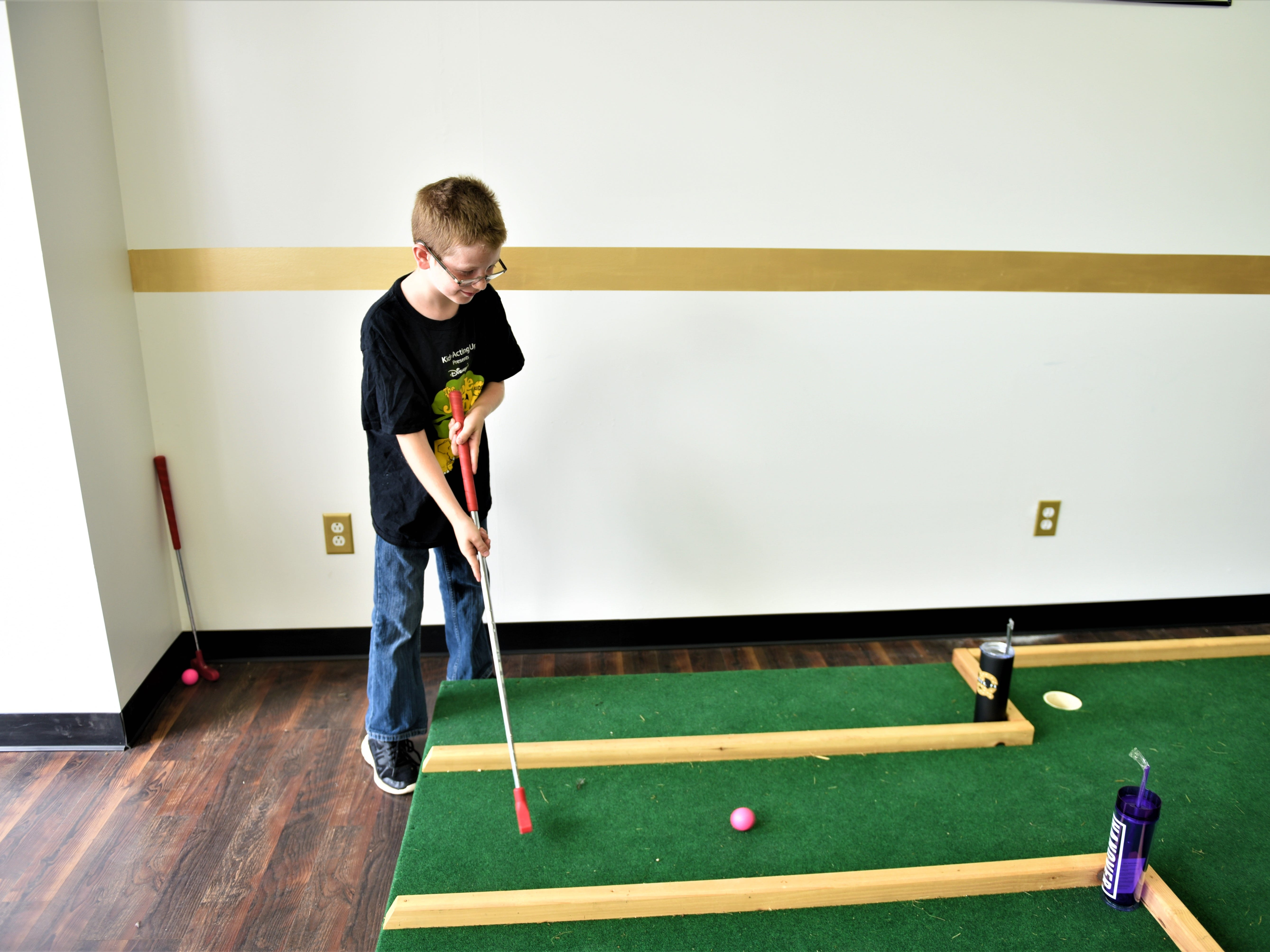 Luke Yeager, 10, playing mini gold at RSVP at the Second Saturday event in Hanover.