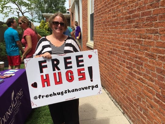 Jennifer Geiman, of Manheim Township, is seen offering free hugs at Second Saturday mini golf.