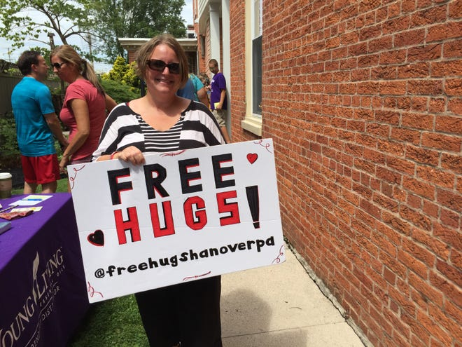 Jennifer Geiman, of Codorus Township, is seen offering free hugs at Second Saturday mini golf.