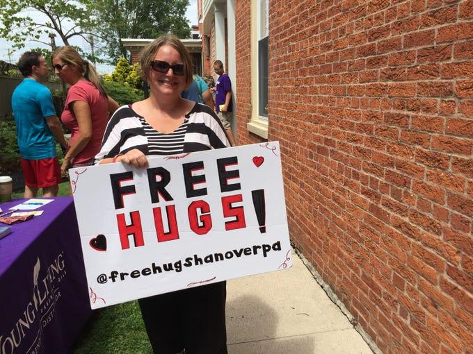 Jennifer Geiman, of Manheim Township, is seen offering free hugs at Second Saturday mini golf.
