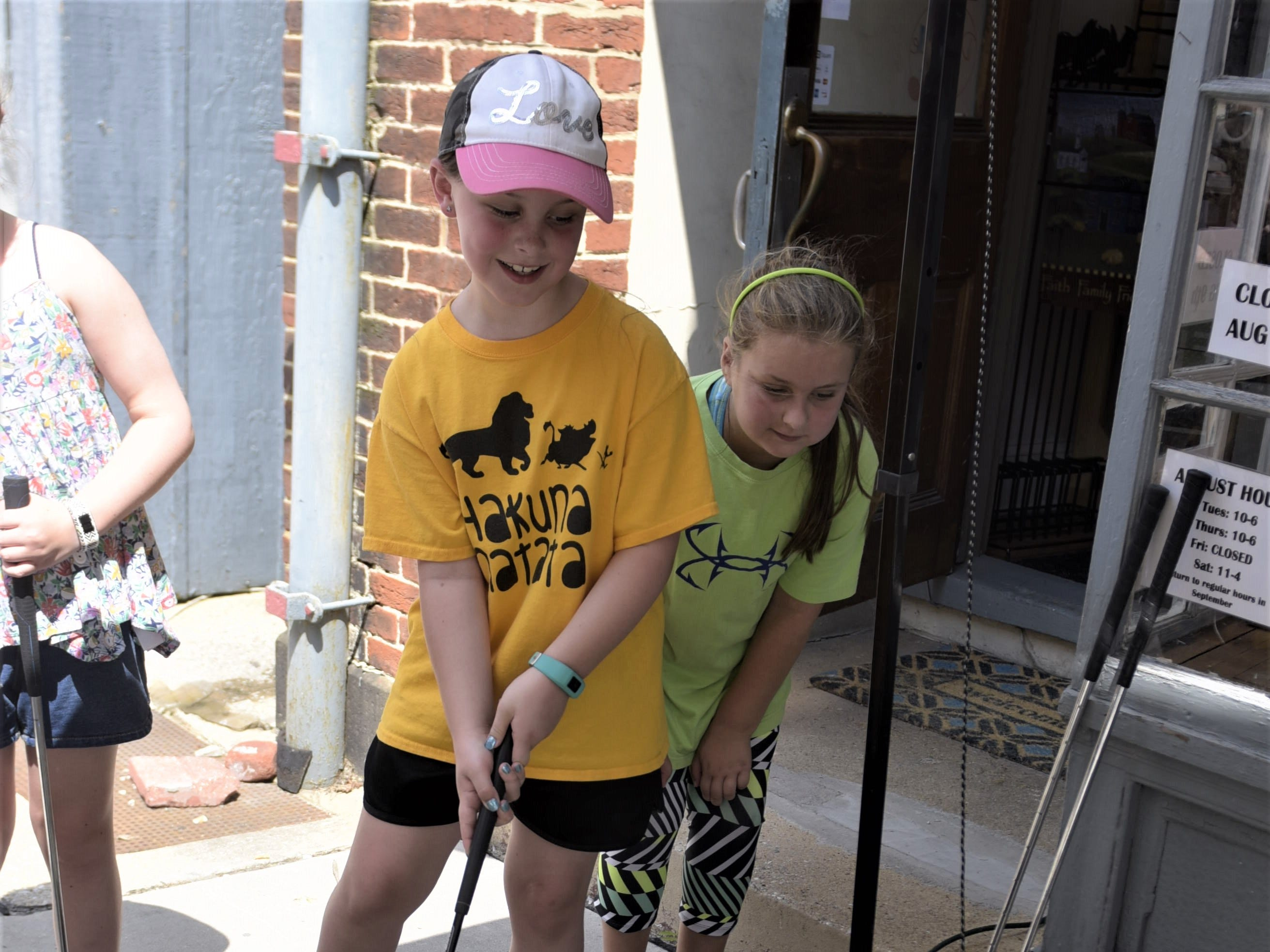 Sophie Staub, 8, is par for the course at Shabby Shique's mini golf hole.