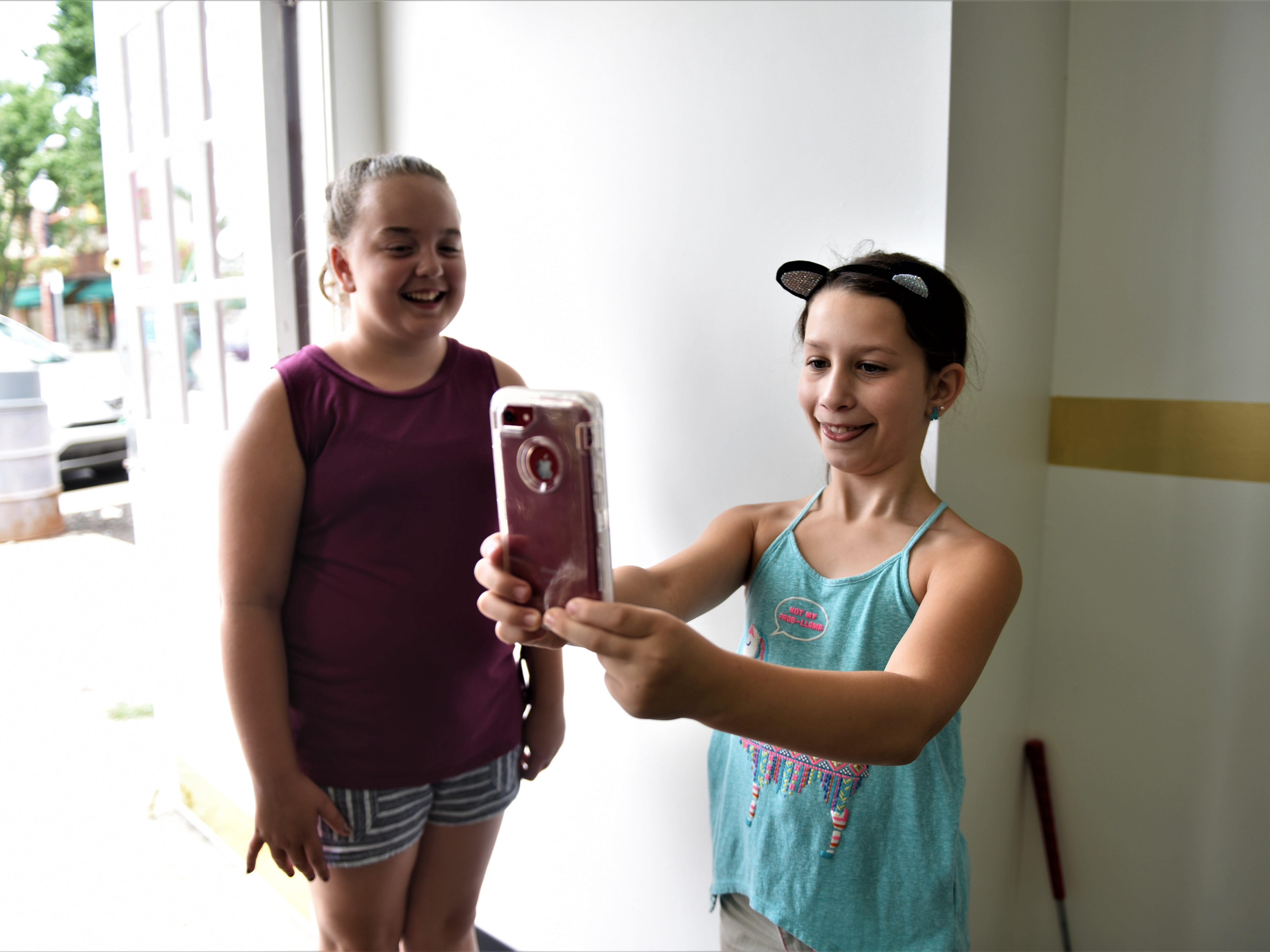 Stella Rice, 11, and Esmae Stillman, 9, (she introduced herself as Esmae Garbanzo Bean) are taking a selfie in RSVP on Aug. 11.