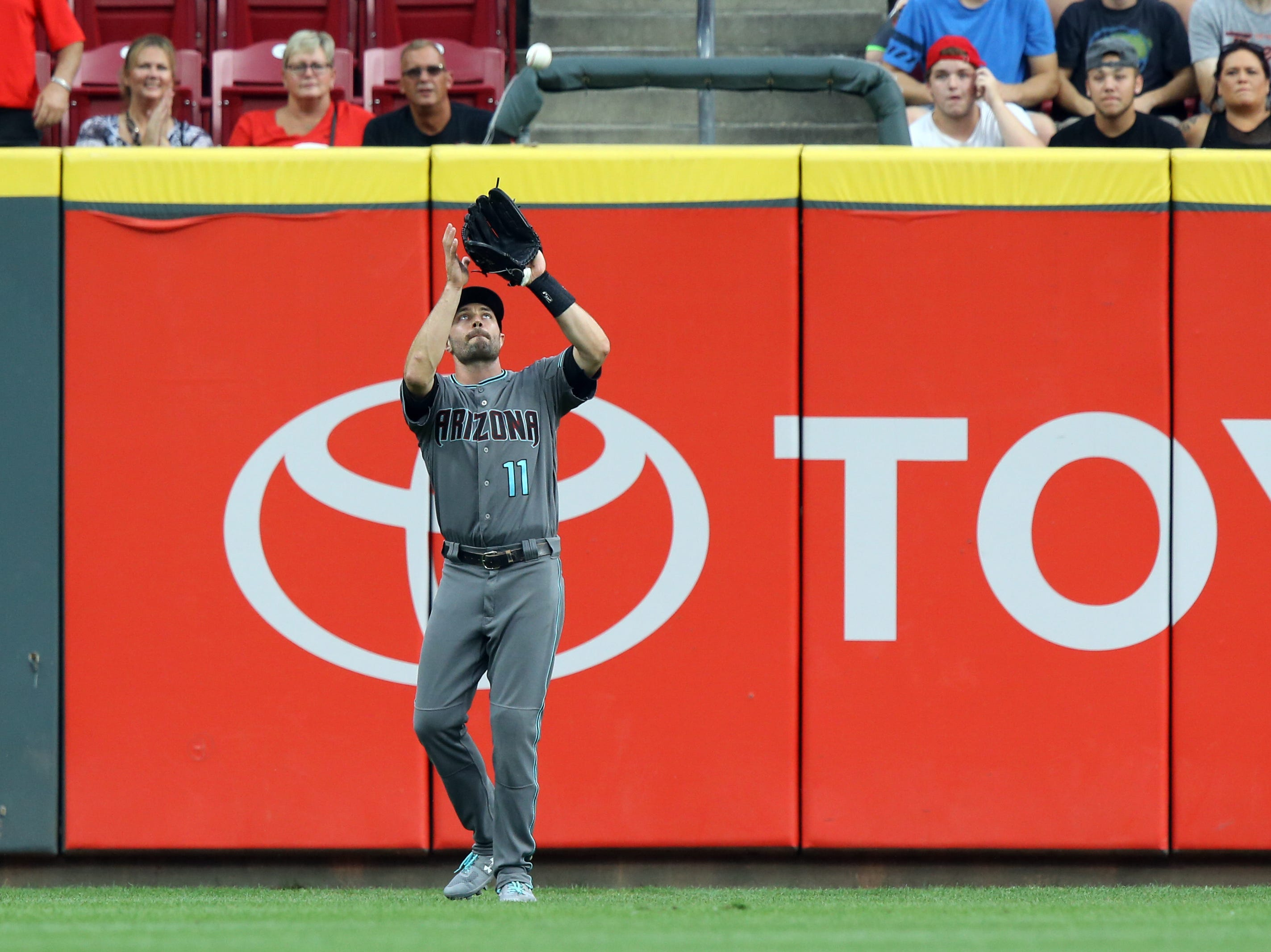 Aug 10, 2018; Cincinnati, OH, USA; Arizona Diamondbacks center fielder A.J. Pollock (11) catches a fly ball hit by Cincinnati Reds second baseman Jose Peraza (not pictured) in the first inning at Great American Ball Park.