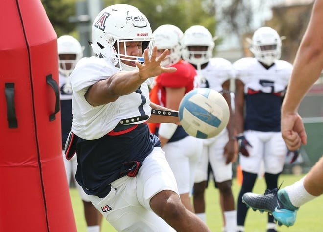 Linebacker Tony Fields II does a drill with a volleyball during practice.