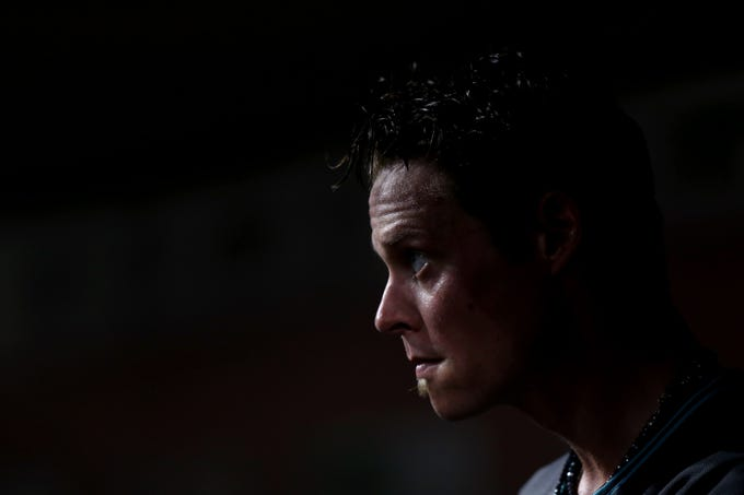 Aug 10, 2018; Cincinnati, OH, USA; Arizona Diamondbacks starting pitcher Clay Buchholz (32) stands in the dugout against the Cincinnati Reds in the eighth inning at Great American Ball Park. Mandatory Credit: Aaron Doster-USA TODAY Sports