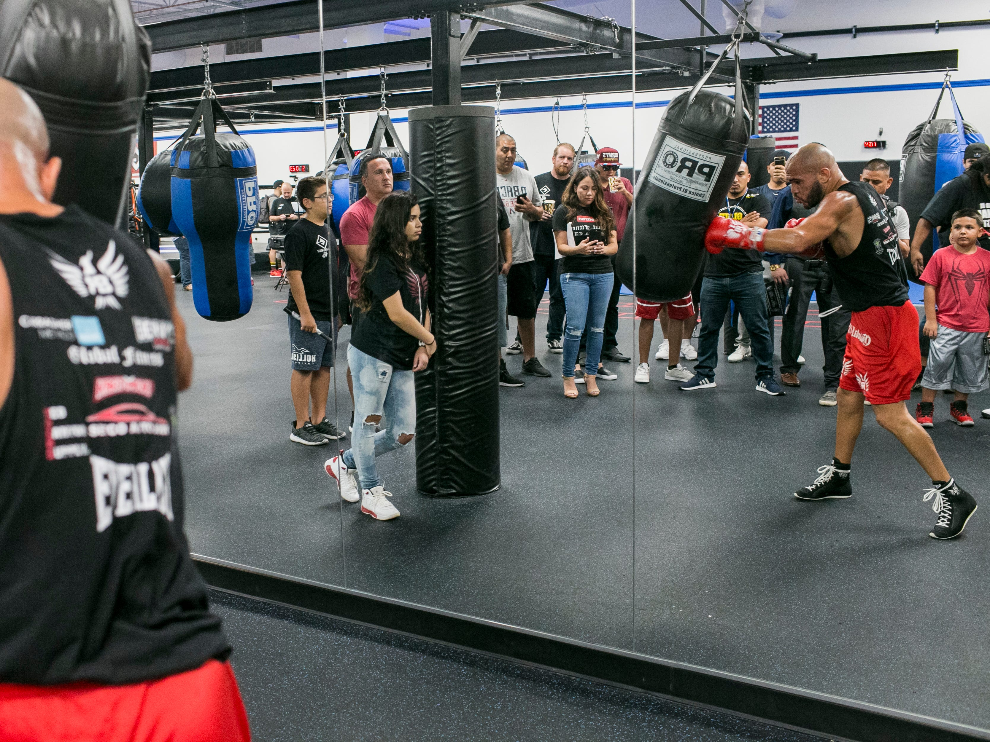 Ray Beltran, the World Boxing Organization World Lightweight champion, hits a punching bag at a media day event at Gent's Boxing Club in Glendale, Ariz. on Sat. Aug 4, 2018.
