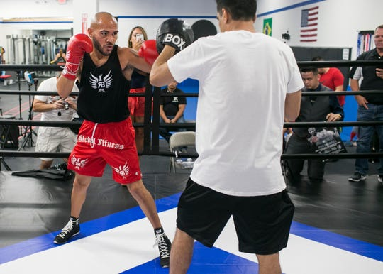 Ray Beltran, the World Boxing Organization World Lightweight champion, spars at a media day event at Gent's Boxing Club in Glendale, Ariz. on Sat. Aug 4, 2018.