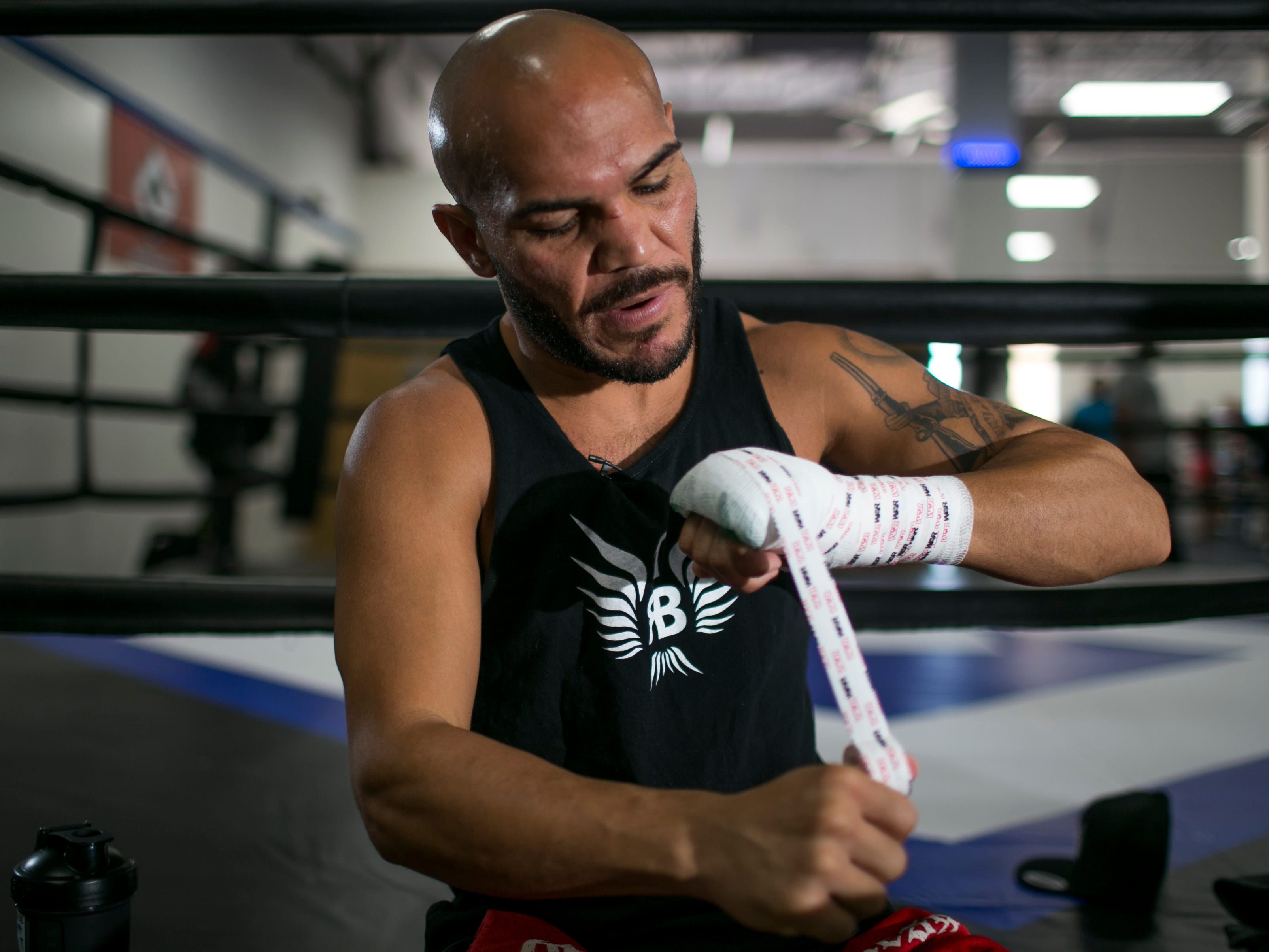 Ray Beltran, the World Boxing Organization World Lightweight champion, puts tape on his hands before sparring at Gent's Boxing Club in Glendale on Aug 4, 2018.