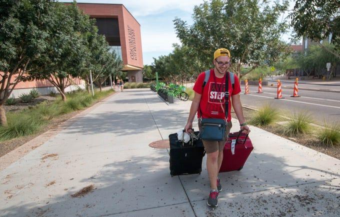 Jake Bradford of Kansas City, Missouri, makes his way to his dorm on ASU's Tempe campus on Aug. 11, 2018.