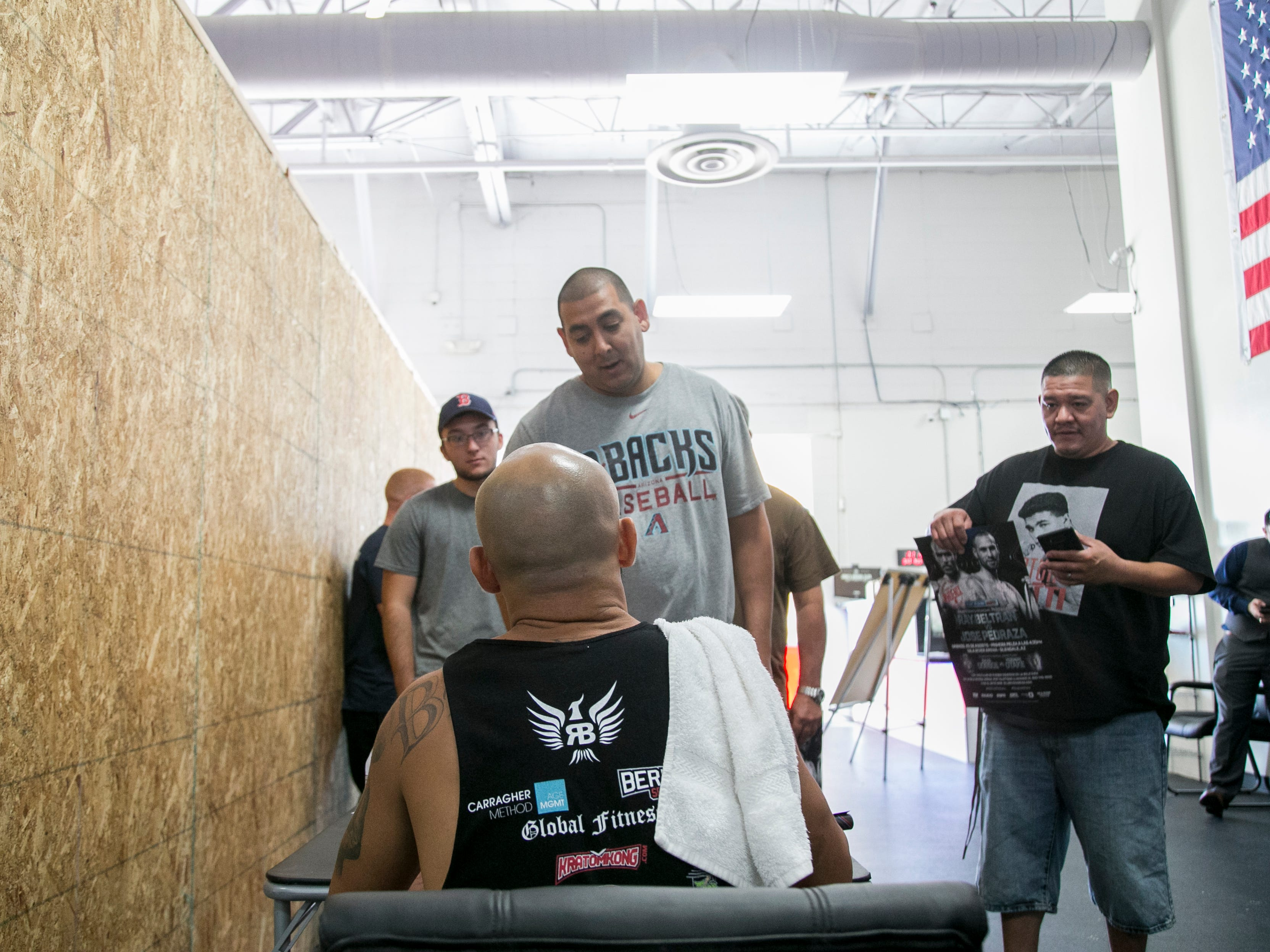 Ray Beltran, the World Boxing Organization World Lightweight champion, signs autographs at a media day event at Gent's Boxing Club in Glendale, Ariz. on Sat. Aug 4, 2018.
