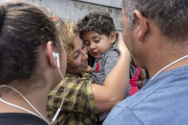 Sandra Patricia Castaneda, 35, hugs her 2-year-old son, Abdiel, after arriving in Guatemala City. Castaneda was caught entering the U.S. illegally on May 25, 2018, with her oldest son who was sent to a shelter for migrant children in Arizona while she was deported.
